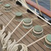 Row of Rope Pulleys on Sailboat Deck